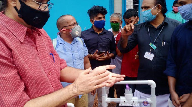 Edn Minister C Raveendranath hands over Vidya's Hands-free Sanitizer Dispenser to Puthukkad taluk Hospital